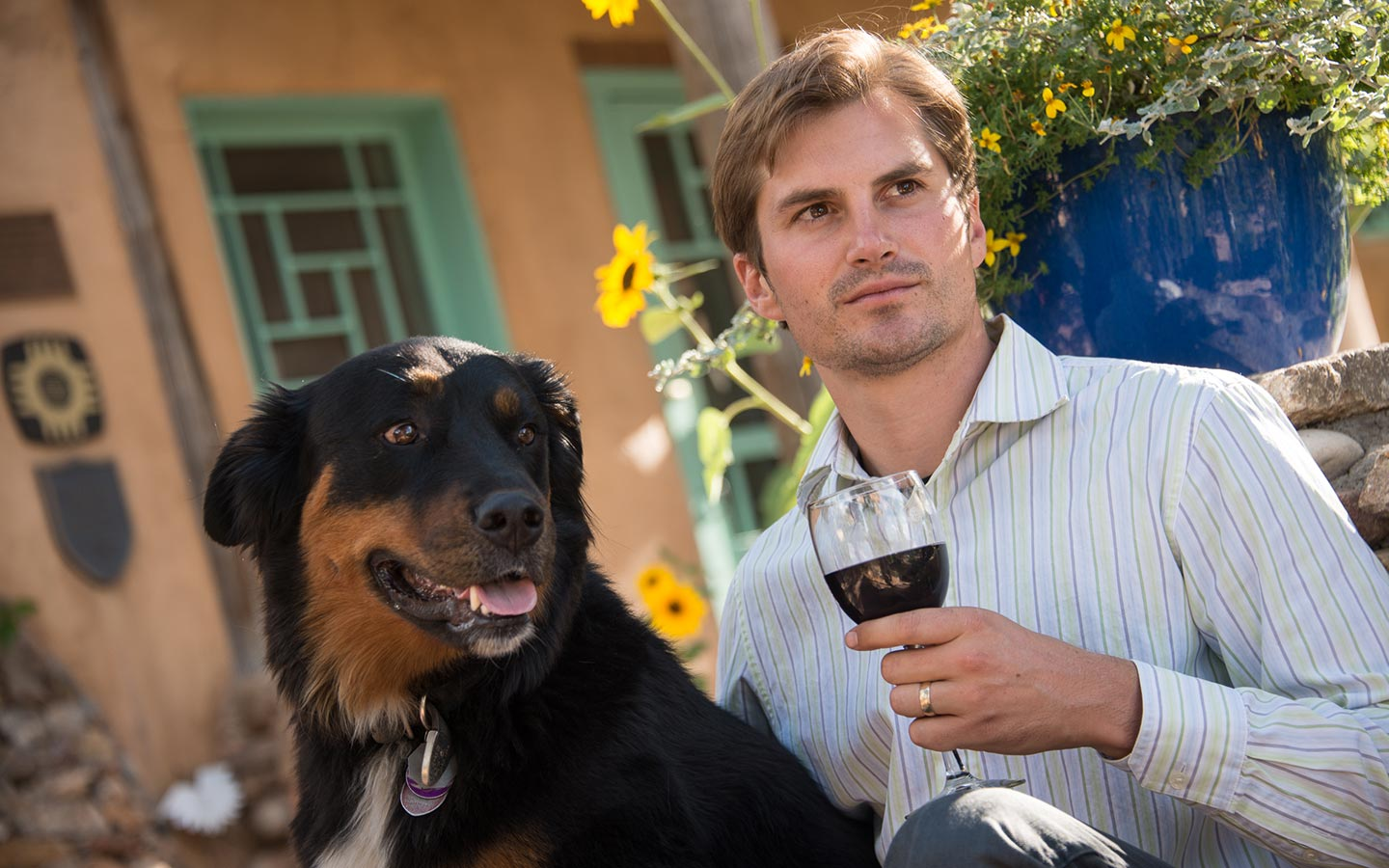 Santa Fe Pet Friendly Lodging a glass of wine with mans best friend.