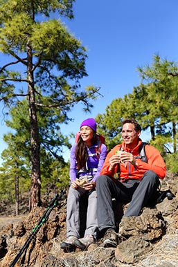 Couple resting during their hike in Santa Fe