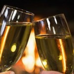 champagne toast in front of a fire