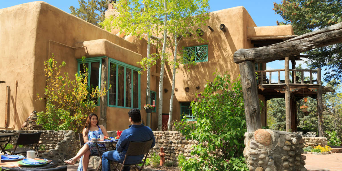 Santa Fe Top Rated Bed and Breakfast - Couple on the Patio