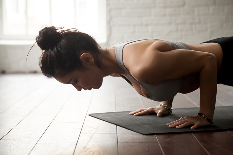 Woman Doing Yoga in Plank Position