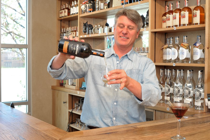 owner of Santa Fe Spirits pouring a drink