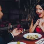 man with ring during romantic dinner proposal