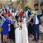 Brides on the steps of the Inn celebrating with their family