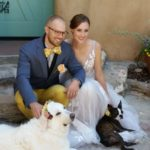 Wedding couple with dogs outside Inn