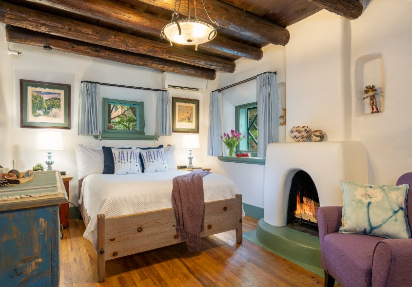 Beautiful O Henry guest room, two windows, queen sized bed, fire in fireplace and sitting chair