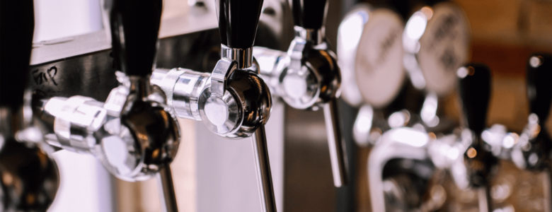 Row of stainless steel beer taps
