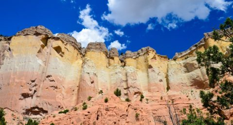 Beautiful mountains in New Mexico, painted-like pastel colors against a brilliant blue sky