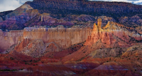New Mexico mountains in shades of pink, burgundy and purple