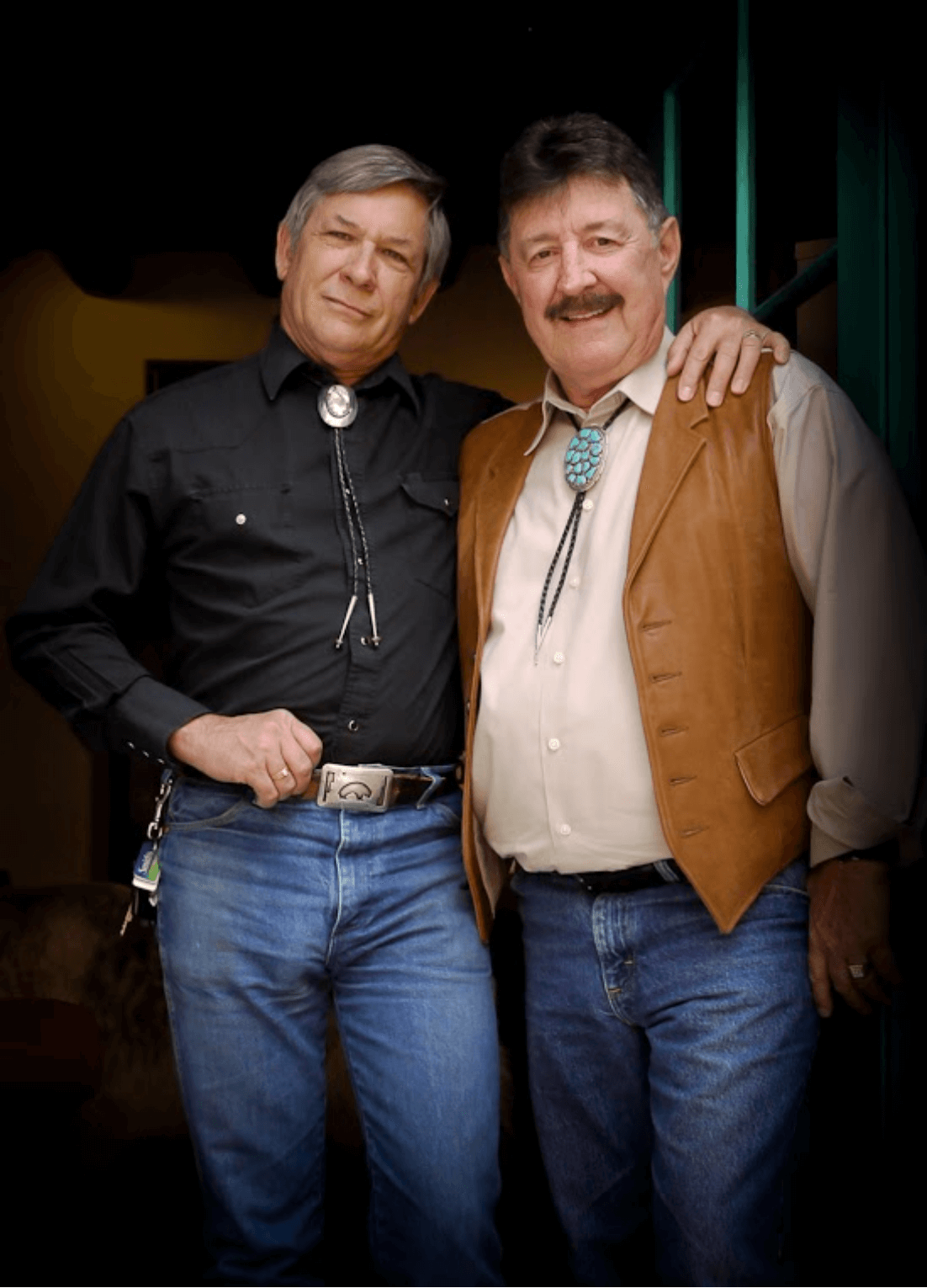 Robert Frost and Richard Bolton standing together wearing western clothing