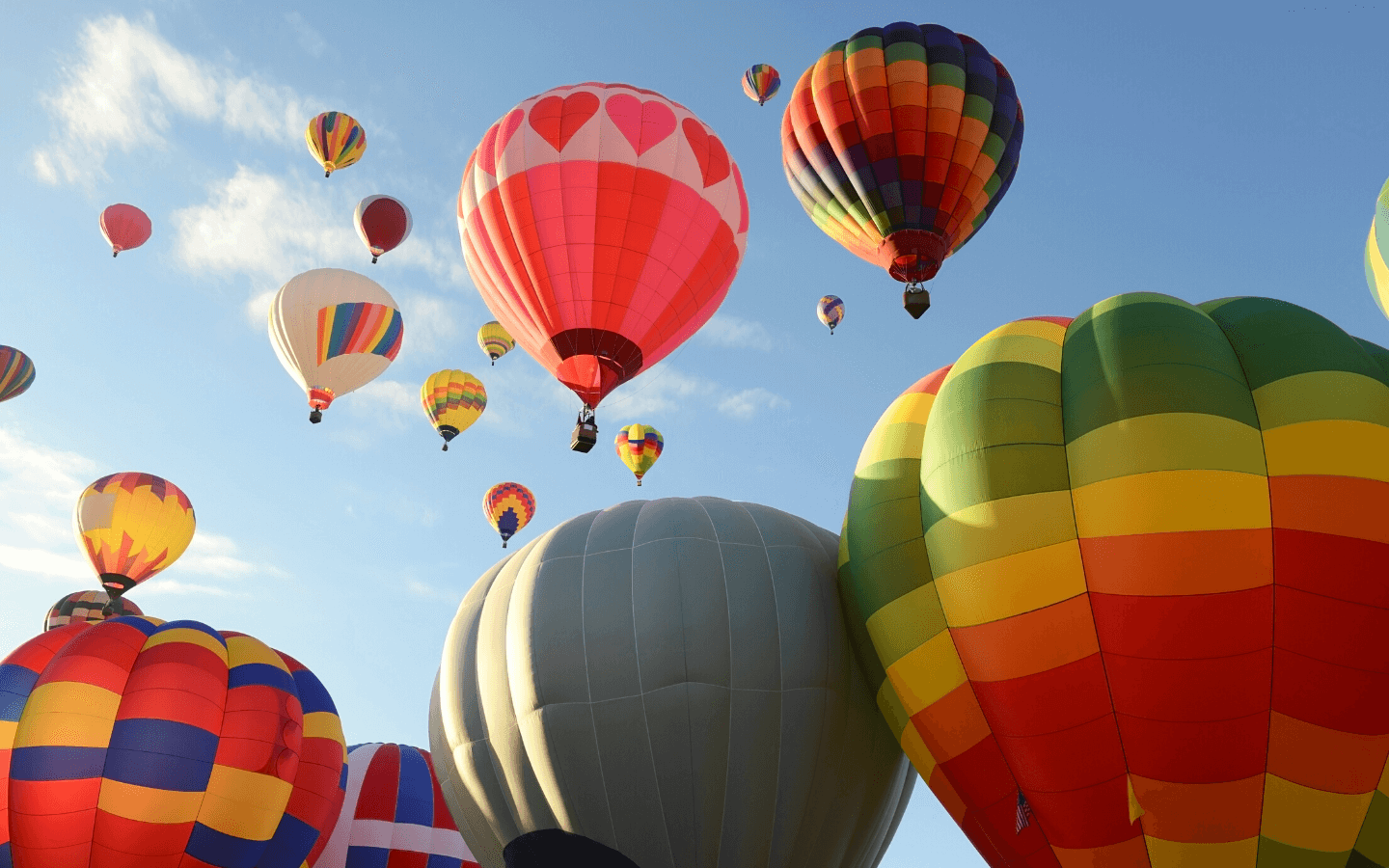 Colorful hot air balloons rising into the sky.
